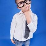 Six years thoughtful boy wearing geek glasses — Stock Photo