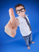 Six years old boy with thumb up — Stock Photo