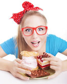 Funny woman eating dessert — Stockfoto