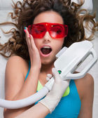 Woman getting laser face treatment — Foto Stock
