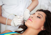 Woman getting laser face treatment — Stock Photo