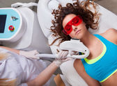 Woman getting laser face treatment — Foto de Stock