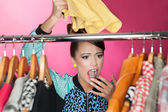 Woman searching for clothing — Stock Photo