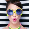Surprised young woman wearing sunglasses — Stock Photo #45923371
