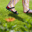 Woman wearing spiked lawn revitalizing aerating shoes — Stock Photo #49904547