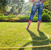 Woman holding garden water hose — Stock Photo