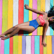African american woman on a wooden pier — Stock Photo