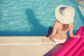 Tanning woman at the swimming pool — Stock Photo