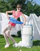 Woman with vintage wringer washing machine — Stock Photo
