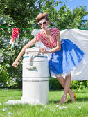 Woman with vintage wringer washing machine — Foto de Stock
