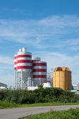 Storage tanks with red stripes — Stock Photo