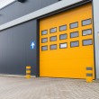 Yellow loading door in industrial warehouse — Stock Photo