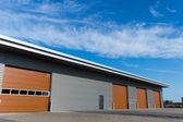 New storage warehouse with brown doors — Stock Photo