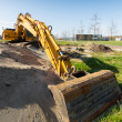 Yellow excavator at construction site — Stock Photo