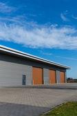 Warehouse with brown door — Stock Photo
