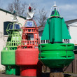 Beacon buoy two green one red on shore — Stock Photo