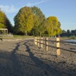 Wooden fences and beach front Blue lake park. — Stock Photo #33160753