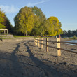 Wooden fences and beach front Blue lake park. — Stock Photo