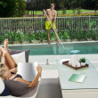 Attractive woman and pool boy — Stock Photo #19838277
