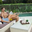 Young couple poolside — Stock Photo #19838299