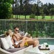 Young couple poolside — Stock Photo #19838315