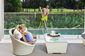 Attractive woman and pool boy — Stock Photo