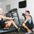 Couple in gym — Stock Photo