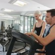 Couple in gym — Stockfoto #22690837
