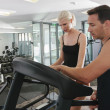 Couple in gym — Stock Photo #22690897