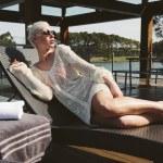 Girl on sunbed — Stock Photo