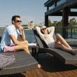 Couple on sunbed — Foto de Stock