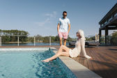 Couple poolside — Stock Photo