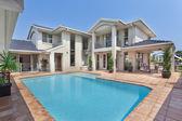 Beautiful backyard with pool in australian mansion — Foto de Stock