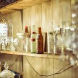 Shelf and crystal lamp in thrift store — Stock Photo #44854431