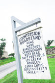 Rustic wooden sign roadside — Stock Photo