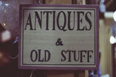 Antiques and old stuff sign — Stock Photo
