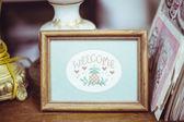 Cute vintage framed welcome crosstich — Foto de Stock