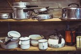 Shelves cluttered with pots and pans — Stock Photo