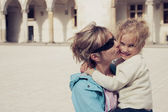 Mom kissing her daughter — Stock Photo