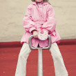 Little girl on a seesaw — Stock Photo