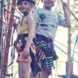 Girl and boy in adventure park - ストック写真