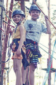 Girl and boy in adventure park — Stok fotoğraf