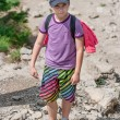 Boy on mountain trail — Stock Photo