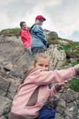 Family hiking in mountains — Stock Photo