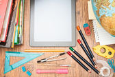 School accessories on a desk — Stock Photo