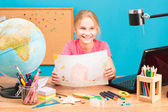 Young smiling girl doing her homework — Foto Stock