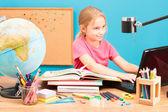Young smiling girl doing her homework — Stockfoto