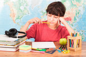 Young boy thinking about his homework — Stock Photo