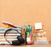 School accessories on desktop with blank pinboard in the backgro — Stock Photo