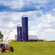 Traditional American Red Barn With Vintage Tractor — Stock Photo #17889279